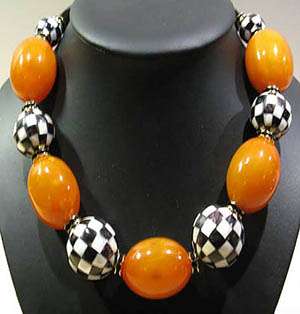 Something Special necklace with chess patterned mother of pearl & orange bakelite: US$950.