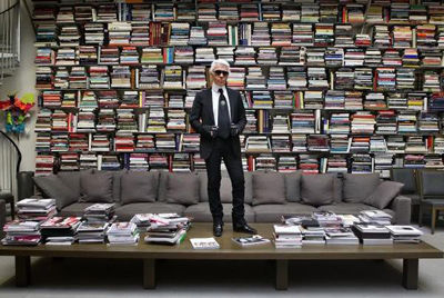 Karl Lagerfeld posing in his Parisian bookstore: 7L, 7 Rue de Lille, 75007 Paris, France.