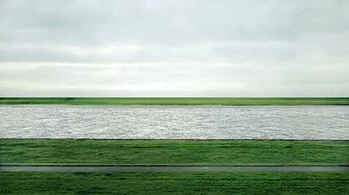Rhein II is a photograph made by German visual artist Andreas Gursky in 1999.