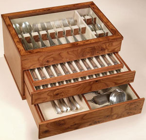 Agresti elm briar and striped mahogany flatware chest.