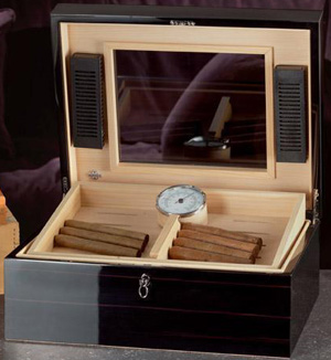 Agresti Polished ebony humidor with tray. Cedar lined. Ruthenium plated hardware: US$1,200.