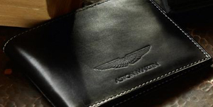 Aston Martin Billfold Wallet In black leather with grey stitching and embossed Aston Martin logo: ?100.