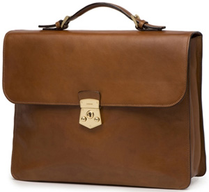 a.testoni: Mid brown hand-rubbed briefcase with vintage lock.