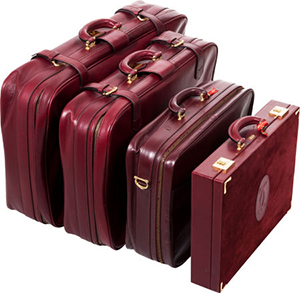Cartier set of four: burgundy leather & suede luggage set.