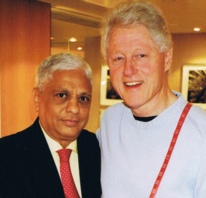 President Bill Clinton with Sam Melwani of Sam's Tailor.