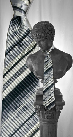 The Custom Shop Clothiers Gray and Black Stripe Pleated Tie: US$395.