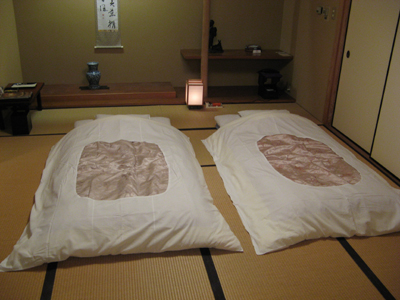 Japanese-style futons laid out for sleeping.