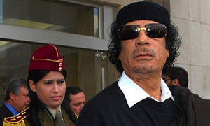Colonel Gaddafi likes wearing sunglasses.