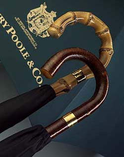 Henry Poole & Co. luxury umbrellas with wooden handles, brass collars engraved with Henry Poole & Co.