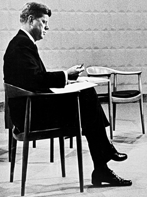 John F. Kennedy seated in The Chair at the 1961 presidential debate.