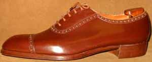 John Lobb Wholecut with Cap Laid Under Facings Brogued Oxford Shoe.