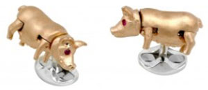 Ruby Eyes Pig Cufflinks, gold: £495.