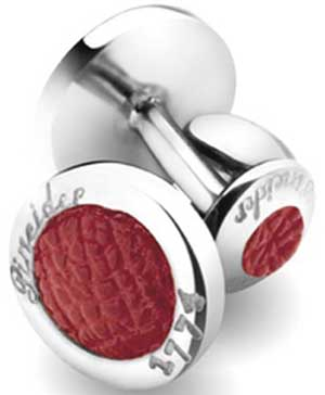 Pineider Round shaped sterling silver and leather cufflinks: £200.