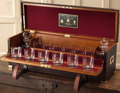 Purdey hand made oak framed, leather covered portable drinks cabinet: £15,000.