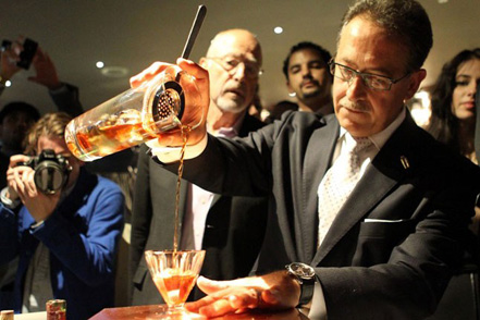 Italian bartender Salvatore Calabrese mixing the world's most expensive cocktail.