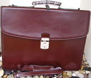 Xezo Maroon Leather Briefcase: US$695.