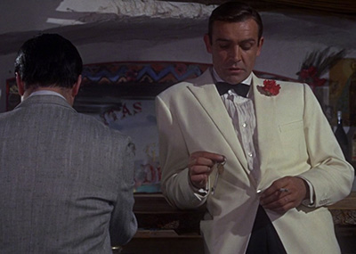 Sean Connery wearing James Bond's first ivory dinner jacket in 'Goldfinger'.