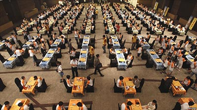 Children participate in a mass contest of Baduk, the Korean version of the Chinese board game Go, in Seoul.