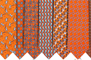 Hermès Printed Orange Hand-Folded 100% Silk Neckties: US$180 each.