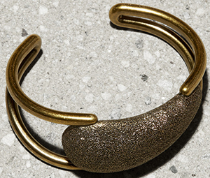 Tomas Maier women's brass cuff with sparked brass nugget focal point: US$490.