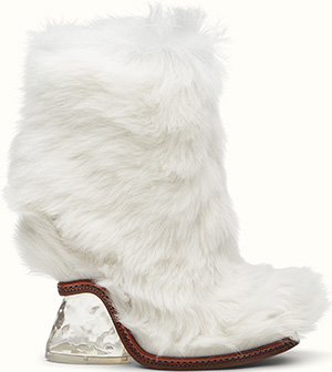 Fendi White lamb fur ankle boots with round toe and wedge: €1,390.