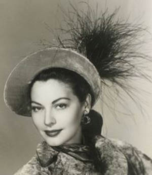 Ava Gardner wearing a hat by Walter Florell.