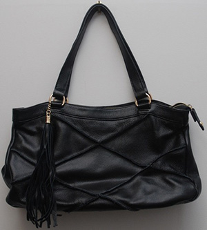 Black Nyla Noor Leather Bag.