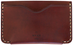 Makr Two exterior card pockets with center partition. Handsewn with burnished edges card holder: US$180.