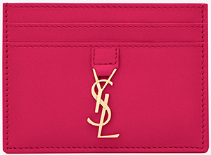 Yves Saint Laurent credit card case in lipstick fuchsia leather: US$225.