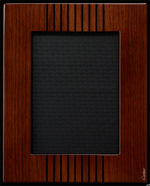 Cartier Transatlantique photo frame in walnut wood. Dimensions: 26 cm wide x 21 cm long.