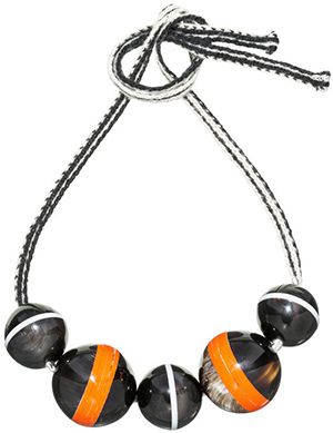 Marni women's necklace with spheres in horn threaded onto a wool ribbon: US$1,020.