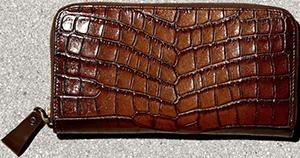 Tomas Maier women's zip around wallet: US$610.