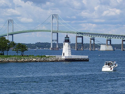 Newport Harbor Light, on Goat Island with the Newport Bridge in the background, Newport, RI 02842.