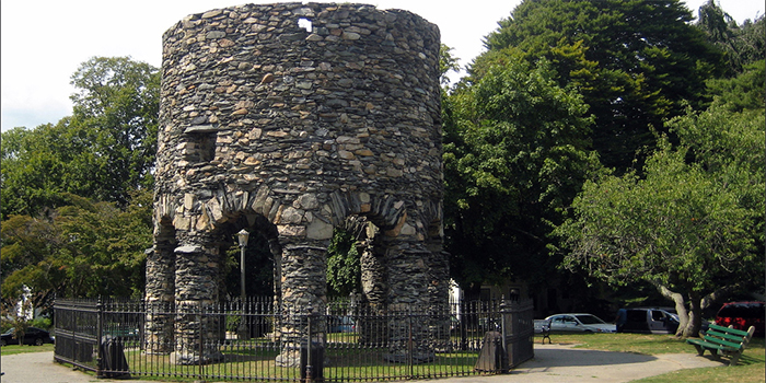 The Newport Tower (also known as: Round Tower, Touro Tower, Newport Stone Tower and Old Stone Mill) is a round stone tower located in Touro Park, Mill Street in Newport, RI 02840, U.S.A.