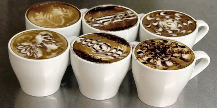 Latte art-made coffees.