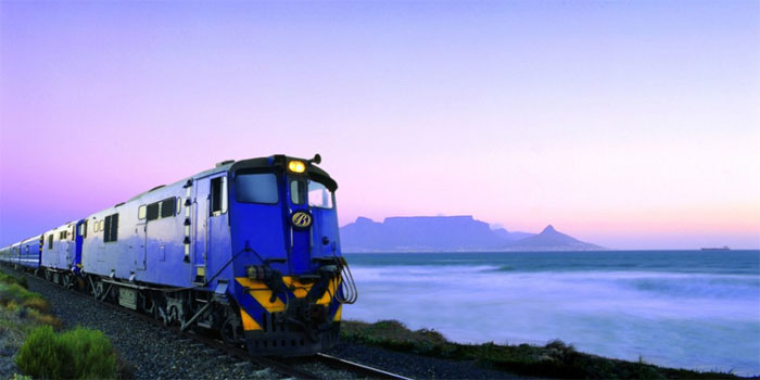 The Blue Train travels an approximately 1,600-kilometer (990 mi) journey in South Africa between Pretoria and Cape Town. It is one of the most luxurious train journeys in the world. It boasts butler service, two lounge cars (smoking and non-smoking), an observation car, and carriages with gold-tinted picture windows, in soundproofed, fully carpeted compartments, each featuring its own en-suite (many of which are equipped with a full-sized bathtub). The service is promoted as a 'magnificent moving five-star hotel' by its operators, who note that kings and presidents have travelled on it.
