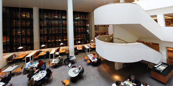 Interior of the British Library, with the smoked glass wall of the King's Library in the background.