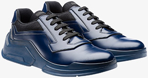 Prada Brushed calf leather men's sneaker with technical fabric inserts.