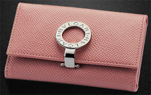 Bvlgari Women's Small flamant rose grain calf leather keychain with brass palladium plated hardware. Six internal keychains and one open inside compartment.