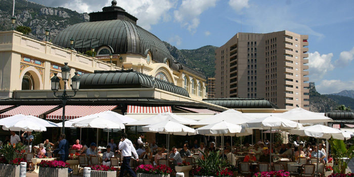 Café de Paris at Place du Casino with luxury apartment building Le Mirabeau in the background.