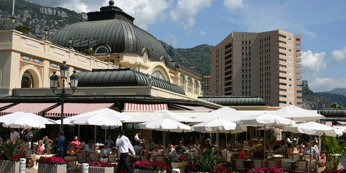 Café de Paris at Place du Casino with luxury apartment building Le Mirabeau in the background.