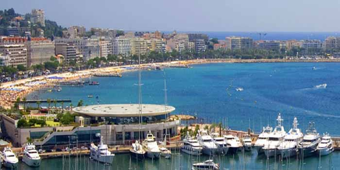 Cannes, Provence-Alpes-Côte d'Azur, Alpes-Maritimes, France - Palais des Festivals et des Congrès in the foreground.