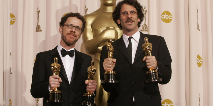 Joel David Coen & Ethan Jesse Coen, known together professionally as the Coen Brothers, at the 2007 Academy Awards with the 4 Oscars won for their film 'No Country for Old Men'.