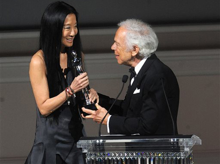 Designer Vera Wang is presented with an award by fellow designer Ralph Lauren at the 2013 CFDA Fashion Awards.