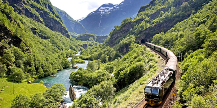 Flåm Railway. One of the world's steepest railway lines on normal gauge. Amazing rail journey between the high mountains and the fjord. One of the most beautiful railway lines in the world.