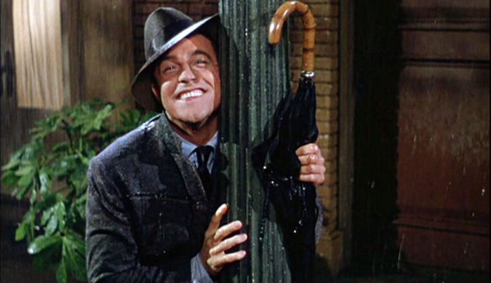 Gene Kelly with his famous umbrella in the film 'Singin' in the Rain'.
