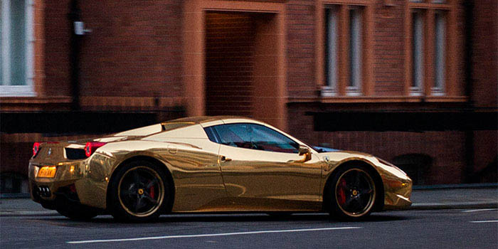 Gold-plated Ferrari 458 Spider powered by a 4.5-litre V8 engine with a top speed of 199 mph.