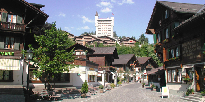 The Promenade in Gstaad village in the summer with the Gstaad Palace hotel in the backgorund, CH-3780 Gstaad, Switzerland.