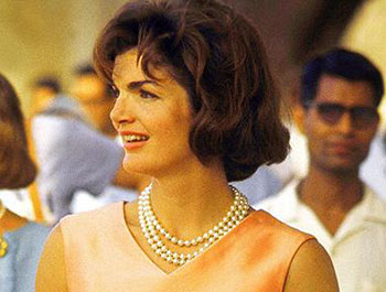 Jackie Kennedy Onassis wearing the three strand set of simulated pearl necklace which sold for over £50,000.