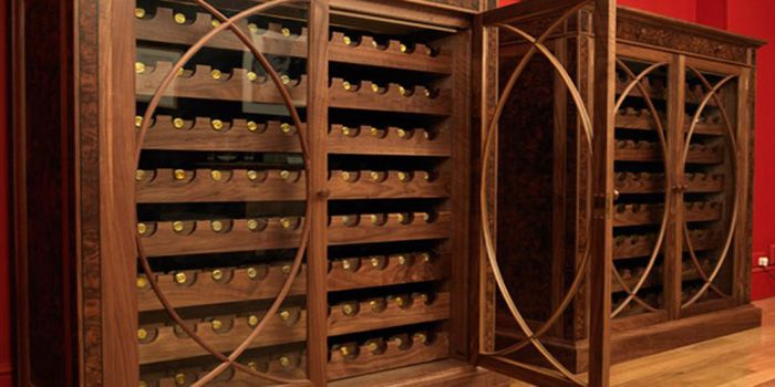 Linley bespoke wine cabinets made in American walnut.